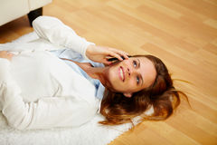 Lovely woman making a call on the cell phone Royalty Free Stock Image