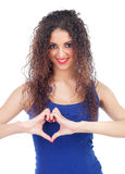 Lovely woman making a heart with her hands Royalty Free Stock Photos