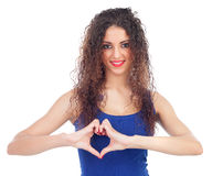 Lovely woman making a heart with her hands Stock Image