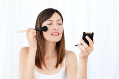 Lovely woman making up Royalty Free Stock Photo