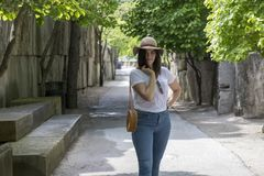 Accessorized woman walking in the park stock image