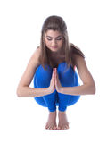 Lovely woman meditates sitting on her haunches Stock Photos