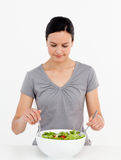 Lovely woman mixing a salad in the kitchen Stock Images