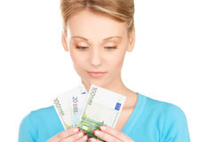 Lovely woman with money Stock Photo