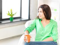 Lovely woman with mug Royalty Free Stock Image
