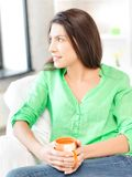 Lovely woman with mug Stock Photo