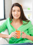 Lovely woman with mug Stock Photos
