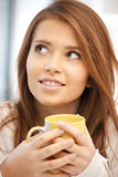Lovely woman with mug Stock Image