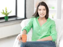 Lovely woman with mug Stock Images