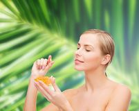 Lovely woman with omega 3 vitamins Stock Photo