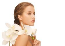 Lovely woman with orchid flower Stock Images