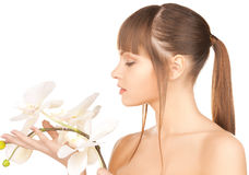 Lovely woman with orchid flower Stock Photography