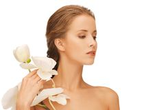 Lovely woman with orchid flower Stock Photos