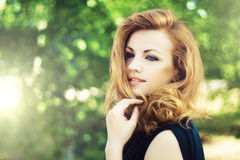 Lovely woman outdoors Royalty Free Stock Image