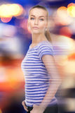Lovely woman over city lights Royalty Free Stock Image
