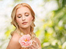 Lovely woman with peony flower Stock Photography