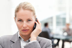 Lovely woman phoning in her office Stock Photos