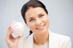 Lovely woman with piggy bank Royalty Free Stock Image