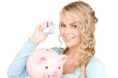 Lovely woman with piggy bank and money. Picture of lovely woman with piggy bank and money Royalty Free Stock Photos