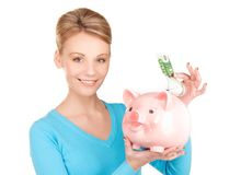 Lovely woman with piggy bank and money. Picture of lovely woman with piggy bank and money Stock Photos