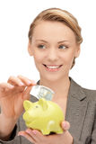 Lovely woman with piggy bank and money Royalty Free Stock Photos