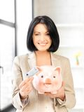 Lovely woman with piggy bank and money Stock Images