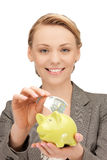 Lovely woman with piggy bank and money. Picture of lovely woman with piggy bank and money Royalty Free Stock Photo