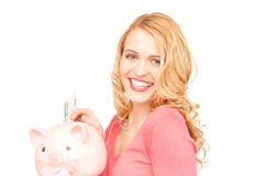 Lovely woman with piggy bank and money Royalty Free Stock Image