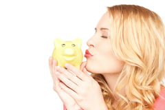 Lovely woman with piggy bank Royalty Free Stock Images