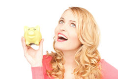 Lovely woman with piggy bank Royalty Free Stock Photos
