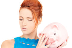 Lovely woman with piggy bank Stock Photo