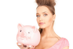 Lovely woman with piggy bank Royalty Free Stock Photography