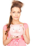 Lovely woman with piggy bank Stock Photos