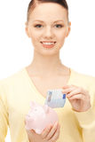 Lovely woman with piggy bank Royalty Free Stock Photo