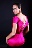 Lovely woman in pink dress Stock Images