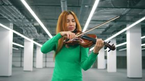 Lovely woman is playing the violin with pleasure. 4K stock video