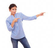 Lovely woman pointing to her left Royalty Free Stock Photos