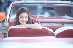 Lovely Woman Posing and and Around a Vintage Car Royalty Free Stock Photography