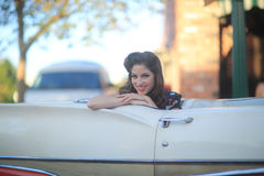 Lovely Woman Posing and and Around a Vintage Car Stock Photography