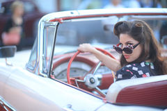 Lovely Woman Posing and and Around a Vintage Car stock photo