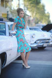 Lovely Woman Posing and and Around a Vintage Car Stock Photos