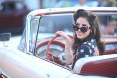 Lovely Woman Posing and and Around a Vintage Car Royalty Free Stock Image