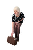 Lovely woman posing with retro suitcase Stock Image