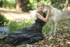 Lovely Woman Posing With a Wolf Stock Photography