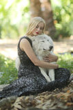 Lovely Woman Posing With a Wolf Stock Photos
