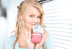 Lovely woman with purse and money Royalty Free Stock Photo