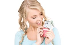 Lovely woman with purse and money Stock Photo