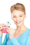 Lovely woman with purse and money Stock Images