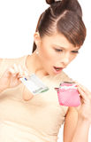 Lovely woman with purse and money Stock Photos