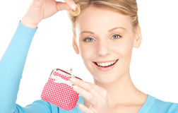 Lovely woman with purse and money Royalty Free Stock Photography